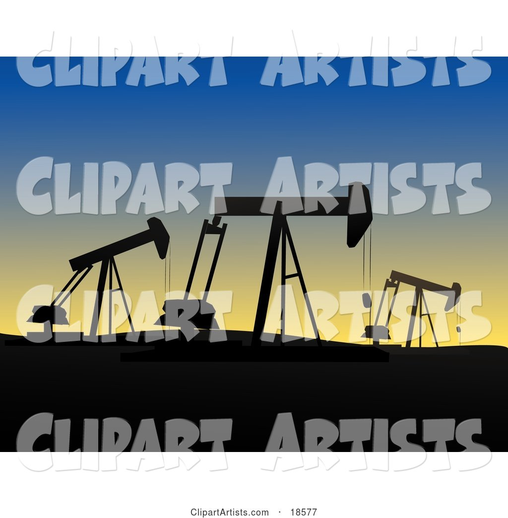 Field of Oil Derricks or Pump Jacks Silhouetted Against the Evening Sky While at Work in Oil Fields