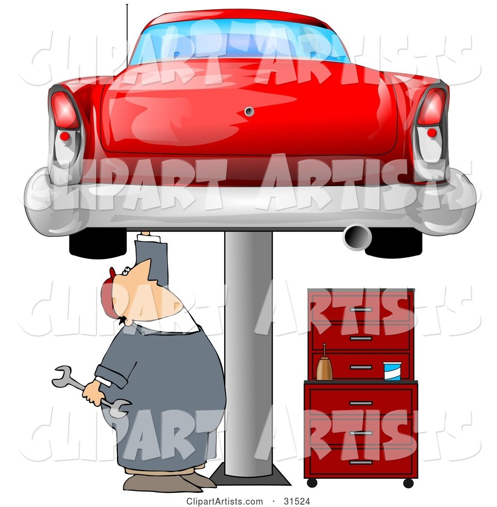 White Male Mechanic Holding a Wrench and Working on a Red Classic Car up on a Lift in a Garage
