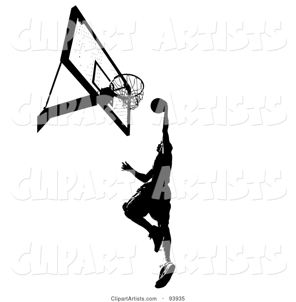 Black Silhouetted Man Leaping Towards a Basketball Hoop