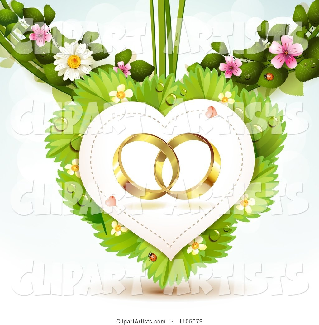 Gold Wedding Rings in a Heart on Leaves with Blossoms
