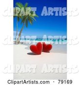 Couple of Red Hearts near Palm Trees on a Tropical Beach