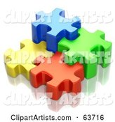 Different Sized Blue, Green, Red and Yellow Puzzle Pieces
