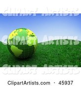 Shiny Green Globe Resting on a Grassy Hill Under a Blue Sky