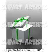 White Gift Box Wrapped with a Green Bow and Ribbons