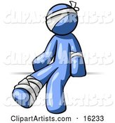 Injured Blue Man Sitting in the Emergency Room After Being Bandaged up on the Head, Arm and Ankle Following an Accident