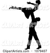 Silhouetted Male Dancer Lifting up His Partner