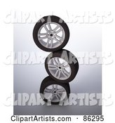 Stack of Three Rims and Tires