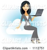 Beautiful Asian Businesswoman Holding a Laptop on a Cloud