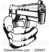 Black and White Hand Holding a Gun
