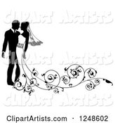 Black and White Silhouetted Wedding Couple with a Swirl Train
