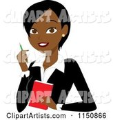 Black or Indian Businesswoman with a Pen and Notepad