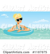Blond Woman Wearing Shades and Floating in an Inner Tube