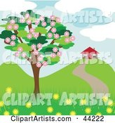 Blossoming Tree near a House in the Spring