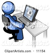Blue Doctor Man Sitting at a Computer and Viewing an Xray of a Head