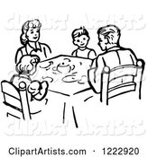 Family Eating Supper at a Table in Black and White
