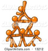 Group of Orange Businessmen Piling up to Form a Pyramid