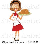 Happy Retro Woman Carrying a Roasted Thanksgiving or Christmas Turkey on a Platter