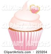 Heart Garnished Cupcake in a Pink Wrapper