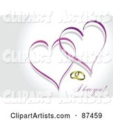 I Love You Message with Wedding Rings and Two Purple Hearts