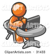 Orange Man Working on a Laptop Computer on a Table