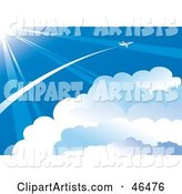 Plane Flying Through the Vast Blue Sky, Above the Clouds and in the Sun Light