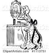 Retro Black and White Woman Looking at a Mirror at Her Vanity Table
