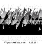 Rows of Black and Gray Silhouetted People Holding Their Hands up in a Crowd at a Music Concert