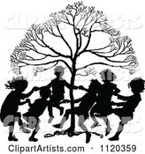 Silhouetted Children Dancing Around a Tree