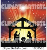 Silhouetted Christian Christmas Nativity Scene Against a Colorful Shining Sky