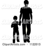 Silhouetted Father and Son Holding Hands