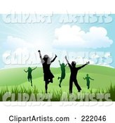 Silhouetted Happy Children Running and Jumping in a Hilly Summer or Spring Landscape