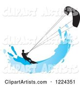 Silhouetted Kite Surfer with a Blue Splash