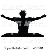 Silhouetted Male DJ Holding His Arm Sup Above Record Decks