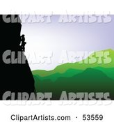 Silhouetted Rock Climber Along a Cliff over a Green Valley
