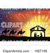 Silhouetted Traditional Christian Nativity Scene with the Three Wise Men and the Manger Against Rays