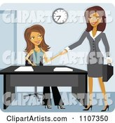 Two Women Shaking Hands While Meeting for a Job Interview